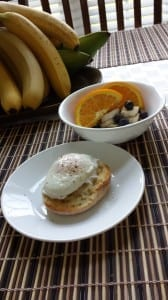 Our breakfast, poached egg on muffin with fresh fruit.